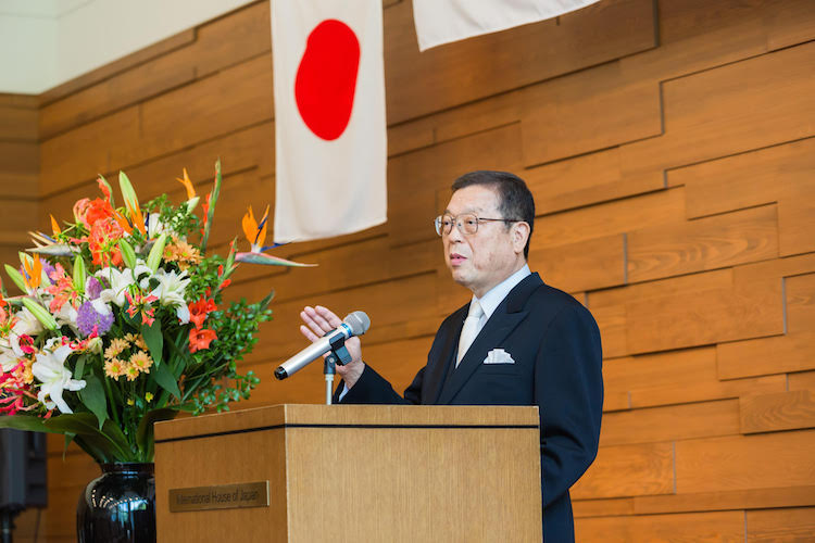 Photo: Fumiyasu Akegawa addressing an audience during one of his visits to Thailand and Vietnam. Credit: DEVNET Japan