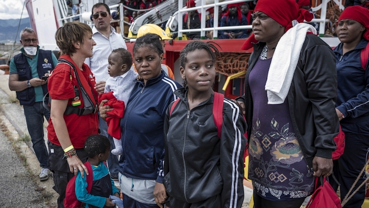 Photo: Unlike 26 African teenage girls, de Awa – with her 1 and 4-year-old children, and her 14-year-old niece – had luck after a rescue ship carried them from waters near Libya across the Mediterranean to Italy. Credit: Louis Leeson/Save the Children