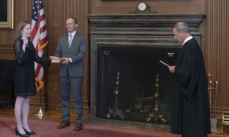 Photo: Chief Justice John Roberts administers the judicial oath to Judge Amy Coney Barrett on October 27, 2020. Judge Barrett's husband, Jesse M. Barrett, holds the Bible. Wikimedia Commons.