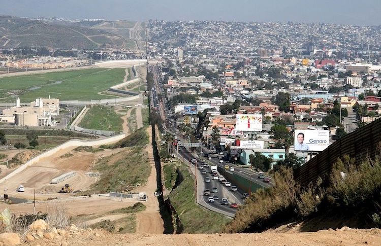 Photo: A small fence separates densely-populated Tijuana, Mexico, right, from the United States in the Border Patrol's San Diego Sector. Construction is underway to extend a secondary fence over the top of this hill and eventually to the Pacific Ocean. Source: Wikimedia Commons.