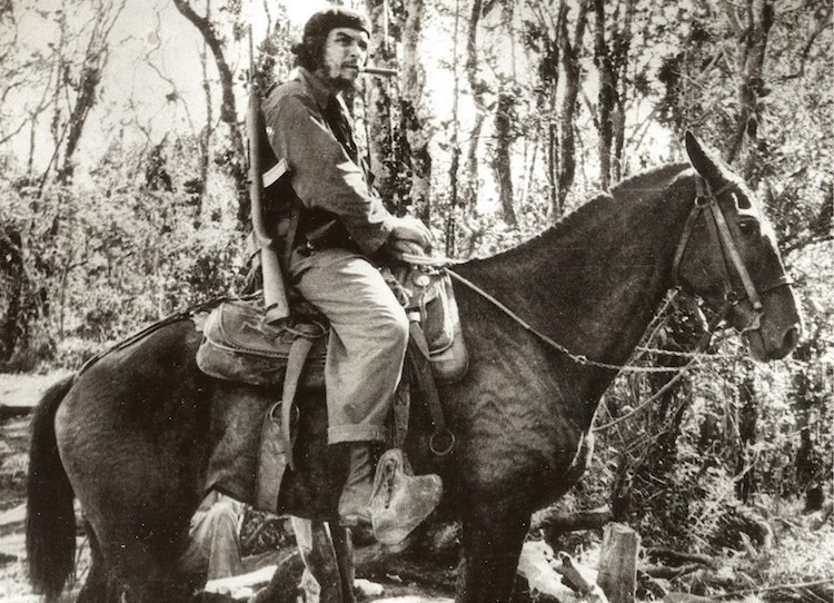 Photo: Guevara atop a mule in Las Villas province, Cuba, November 1958. Wikimedia Commons.