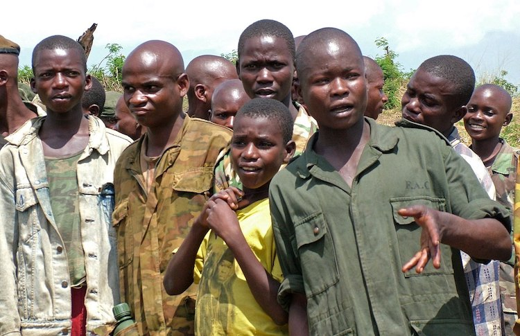 Photo: A group of demobilized child soldiers in the Democratic Republic of the Congo (2000-2007). Credit: Wikimedia Commons.