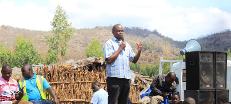 Photo: Maxwell Matewere, addresses a local community in Malawi about the threat of human trafficking. Credit: UNODC