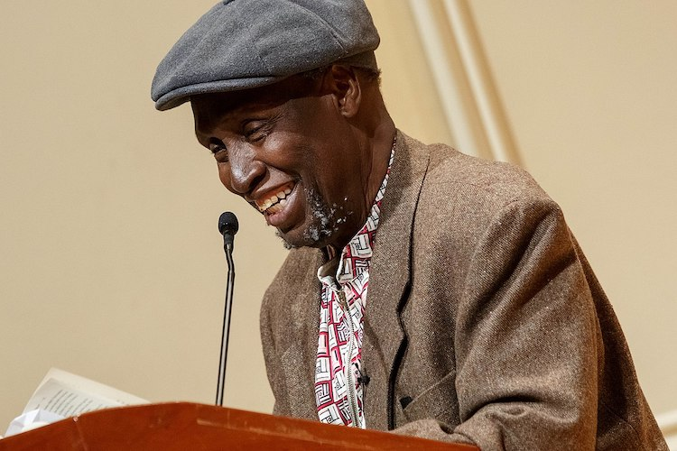 Photo: Renowned Kenyan writer Ngũgĩ wa Thiong'o reads excerpts from his recent work in both Gikuyu and English during a presentation in the Coolidge Auditorium, May 9, 2019. Photo by Shawn Miller/Library of Congress.