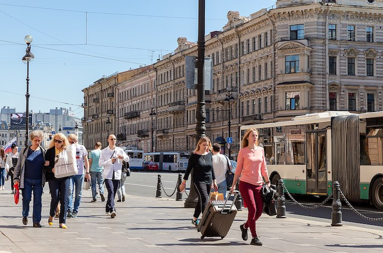 "Photo: Western visitors to Moscow and St Petersburg are often struck by how ""European"" these cities are. Russians in these cities dress like Europeans. The  picture shows people walking on the main street of Saint Petersburg, Nevsky Prospekt C BY 2.0."