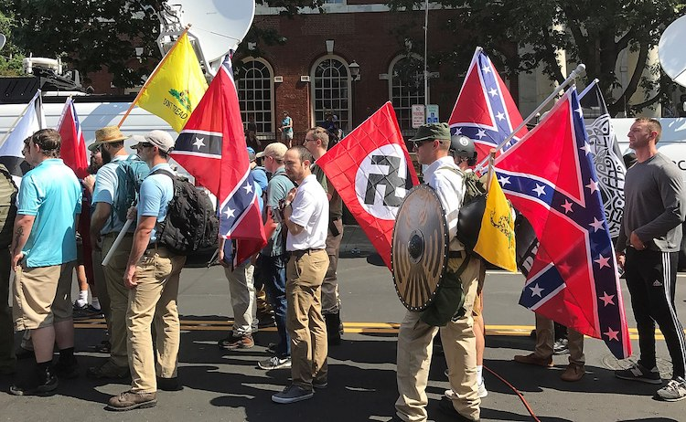 Photo: Prominent alt-rightists were instrumental in organising the Unite the Right rally in Charlottesville, Virginia, in August 2017. Here, rally participants carry Confederate battle flags, Gadsden flags and a Nazi flag. CC BY 2.0
