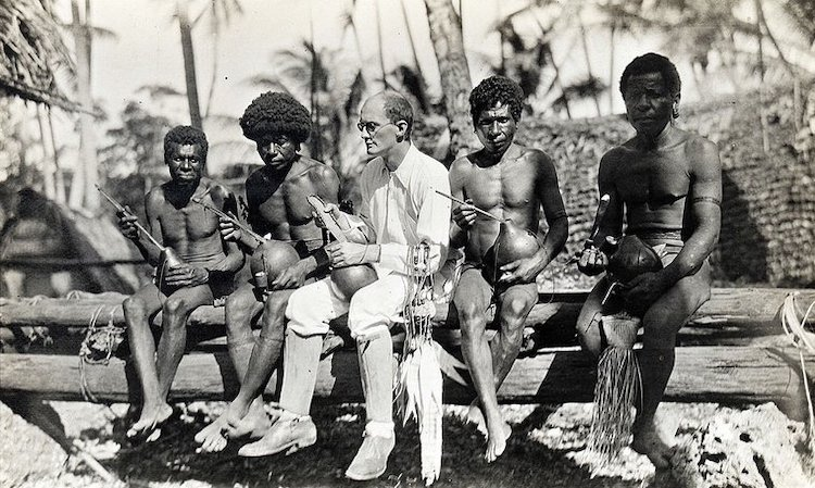 Photo: Bronislaw Malinowski with Trobriand islanders, 1917 – 1918. | Wikicommons/LSE Library Collection. Some rights reserved.