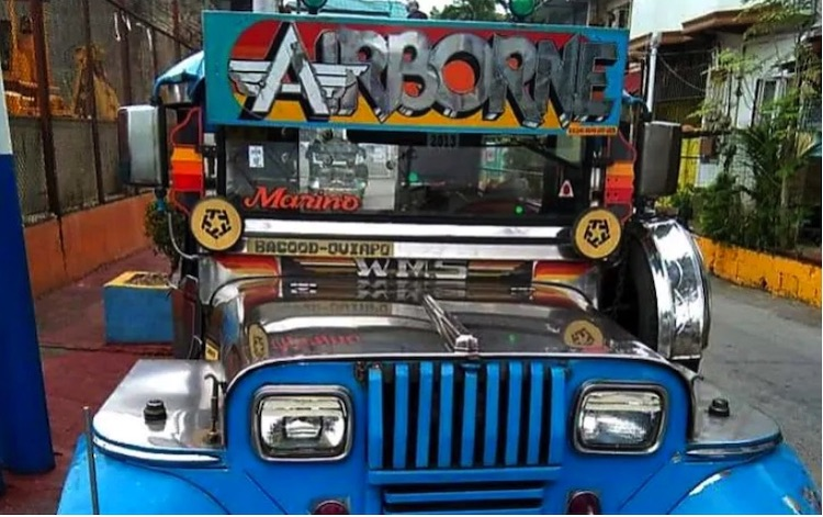 Photo: Drivers of the colourful and traditional 'jeepneys' have been among the hardest-hit populations in the Philippines. Credit: Dan Olanday.