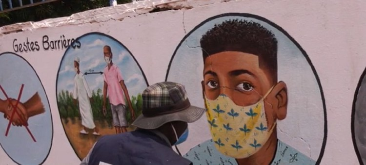 Photo: Artist in the Central African Republic, CAR, painting on walls various tips on how to protect oneself from COVID-19. Credit: MINUSCA/Screenshot