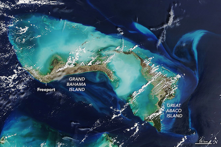 Photo: The Moderate Resolution Imaging Spectroradiometer (MODIS) on NASA's Terra satellite acquired these natural-color images of Great Abaco Island and Grand Bahama on September 7, 2019. Note the change in the color of the island landscape from green to brown, as well as the brightening of the reefs and shoals around the island due to sediments stirred up by the storm. Credit: NASA