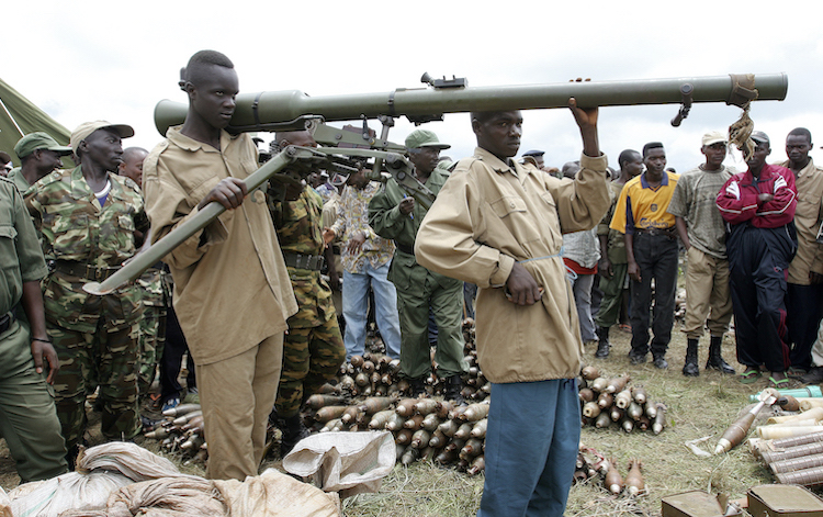 Photo: Members of CNDD-FDD rebel forces surrender their weapons and ammunition to United Nations Operation in Burundi (ONUB) peacekeepers in Mbanda, southern Burundi. 03 February 2005. UN Photo/Martine Perret.