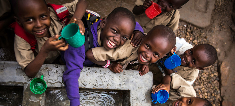 Photo: Children fill their cups at a water point built by UNICEF at Kanyosha III primary school in Bujumbura, Burundi. Credit: UNICEF/UNI180029/Colfs