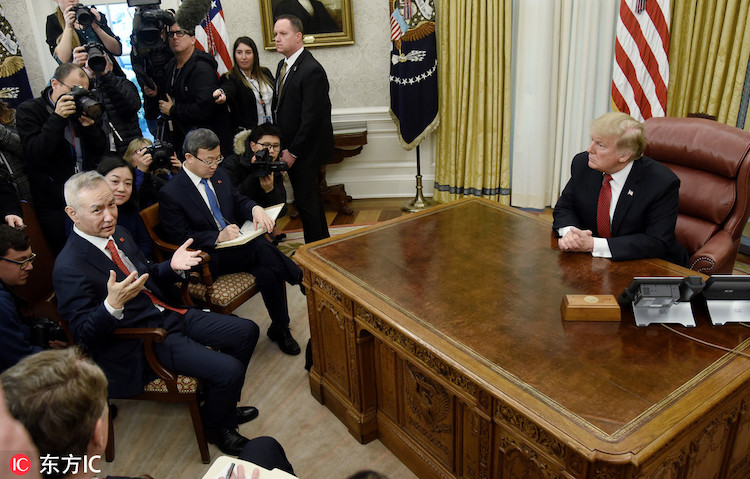 Photo: U.S. President Donald Trump (R) listens to Chinese Vice-Premier Liu He (L) during a meeting to discuss trade issues in the Oval Office of the White House in in Washington, Jan 31, 2019. Credit: IC