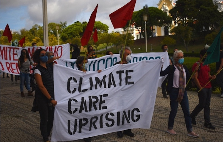 . Photo: Activists with the group Climáximo gathered in Lisbon, Portugal on October 5 as part of the Climate Care Uprising — a wave of actions across Europe organized by the By 2020 We Rise Up platform. (WNV/Pedro Alvim)
