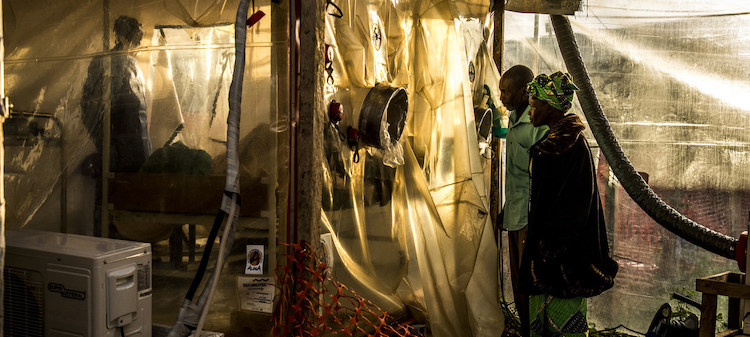 Photo: Parents visiting her 15-year-old daughter, who is suspected of being infected by Ebola, at the Ebola Treatment Center in Beni, DRC (January 2019). Credit: World Bank /Vincent Tremeau.