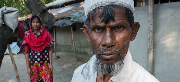 Photo: Farmer Nurul Haque stands near his 13-year-old daughter in Bangladesh, saying he may have to pull her from school and marry her off to an older man because he has few financial options left. Credit: UNICEF/UN0159775/Nybo.