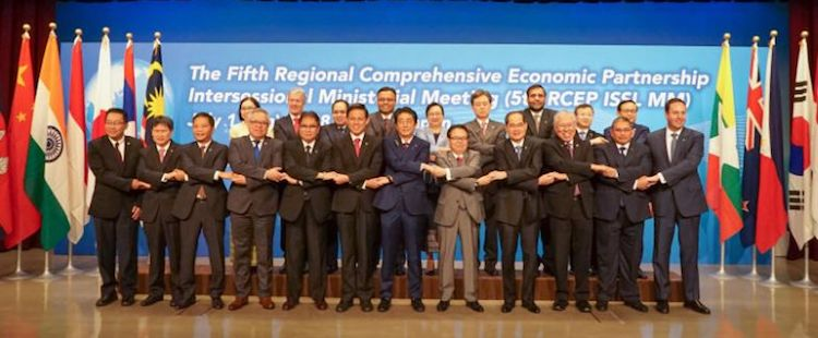 Photo: Trade ministers or representatives, including Singapore's Minister for Trade and Industry Chan Chun Sing (front row, sixth from left), from 16 countries gathering on July 1, 2018 in Tokyo for the Fifth Regional Comprehensive Economic Partnership Intersessional Ministerial Meeting. Credit: XINHUA