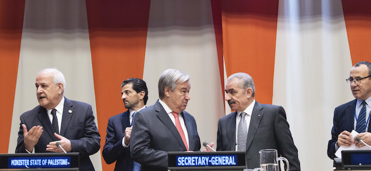 Photo: UN Chief António Guterres (centre) speaks with Mohammad Shtayeh, Chair of the Group of 77 and Prime Minister of the State of Palestine, at the forty-third annual meeting of Ministers for Foreign Affairs of the Group of 77. At left is Riyad H. Mansour, Permanent Observer of the State of Palestine to the United Nations. At right is Mourad Ahmia, G77 Executive Secretary. 27 September 2019. United Nations, New York. Credit: UN Photo/Kim Haughton