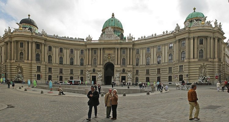 Photo: Vienna Hofburg, the former principal imperial palace of the Habsburg dynasty rulers; which and today serves as the official residence and workplace of the President of Austria. It is located in the center of Vienna and was built in the 13th century and expanded several times afterwards. Credit: Robert Fischer, Pixabay