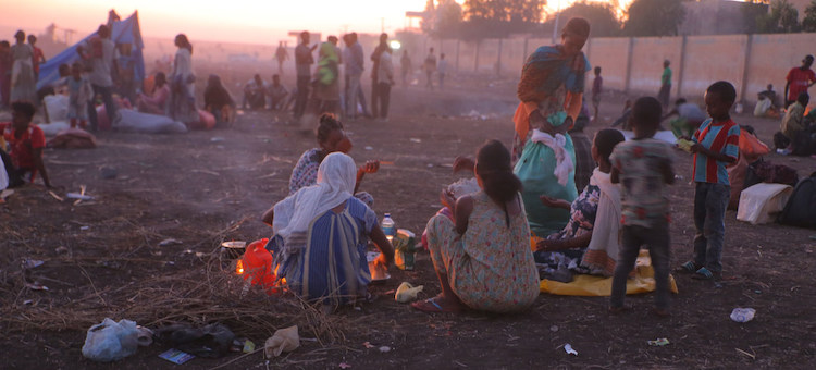 Photo: Ethiopian refugees fleeing clashes in the country's northern Tigray region, rest and cook meals near UNHCR's Hamdayet reception centre after crossing into Sudan. Credit: © UNHCR/Hazim Elhag