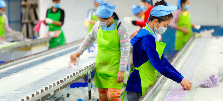 Photo: Factory workers in an assembly line in Cambodia. Credit: ILO/Marcel Crozet