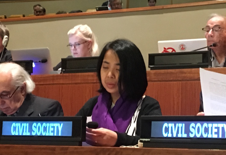 "Photo: Jasmin Nario-Galace of Pax Christi Philippines reading out public statement on behalf of the faith communities on March 28 at the United Nations Conference in New York to negotiate ""a legally binding instrument to prohibit nuclear weapons, leading towards their total elimination"". Credit: Soka Gakkai."