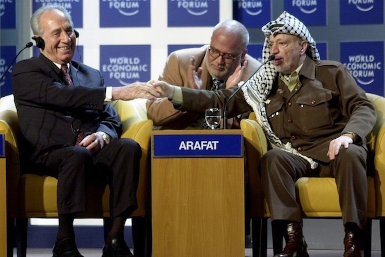 Photo: Twenty-five years since the 1994 Nobel Peace Prize shared by Prime Minister Yitzhak Rabin and Israeli Foreign Minister Shimon Peres with PLO Chairman Yasser Arafat – who negotiated and signed the Oslo Peace Accords – peace continues to evade the Middle East, Palestine-Israel relations remain tense and a Weapons of Mass Destruction (WMD) Zone in the region is nowhere in sight. The picture shows Rabin (left) shaking hands with Arafat (right) at the World Economic Forum in Davos, 2001 | Credit: CC BY-SA World Economic Forum.