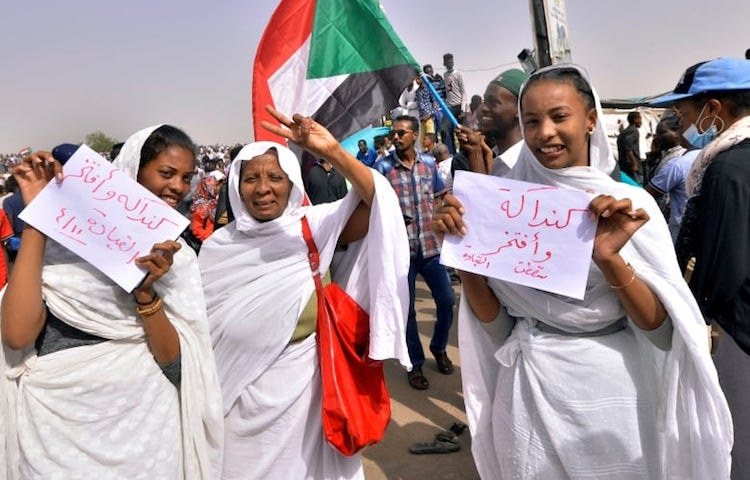 Photo: Sudanese women preparing songs to celebrate ouster of O. al-Bashir