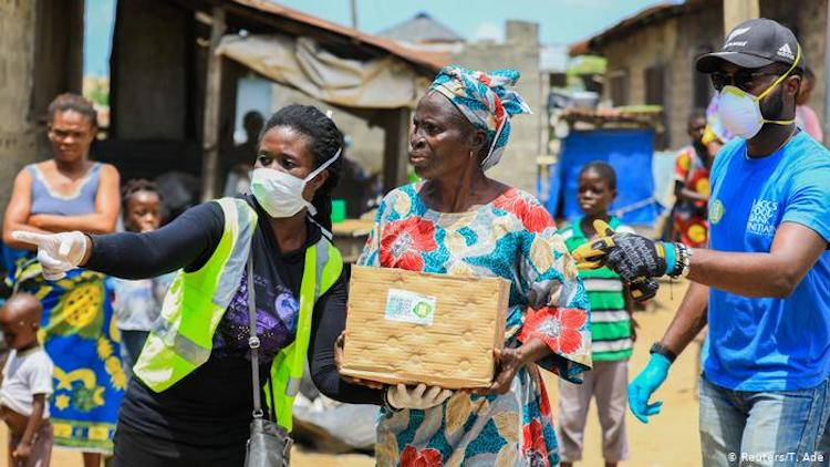 Photo: Volunteer health workers in Lagos, Nigeria, are on the streets to help distribute food. Source: DW.COM
