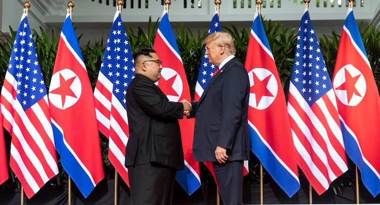 Photo: President Donald J. Trump and North Korean leader Kim Jong Un, shake hands as they meet for the first time, June 12, 2018, at the Capella Hotel in Singapore. (Official White House Photo by Shealah Craighead)