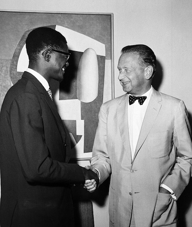 Premier Patrice Lumumba, of the Republic of the Congo, photographed as he met with UN Secretary-General Dag Hammarskjöld (right) at United Nations Headquarters on 24 July 1960 United Nations, New York. UN Photo