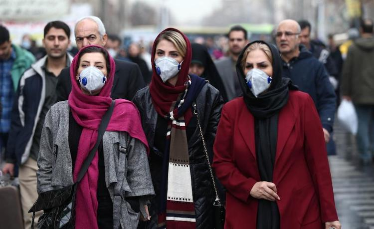 Photo: Iranian women wearing masks to protect themselves from coronavirus walk at the Grand Bazaar in Tehran on February 20, 2020. Credit: © 2020 WANA/Nazanin Tabatabaee via Reuters