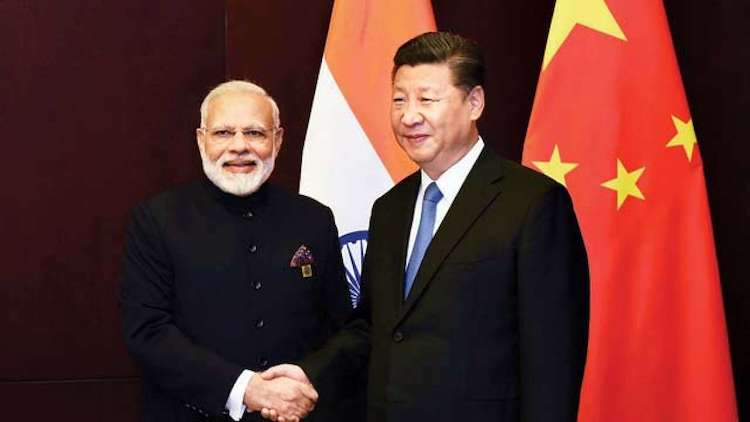 Photo: Prime Minister Narendra Modi shakes hands with Chinese President Xi Jinping. Credit: PTI