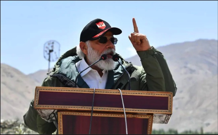 Photo: Prime Minister Narendra Modi addresses the Indian troops during his visit to the forward post at Nimu in Ladakh, Friday, July 3, 2020. Credit: PIB/PTI