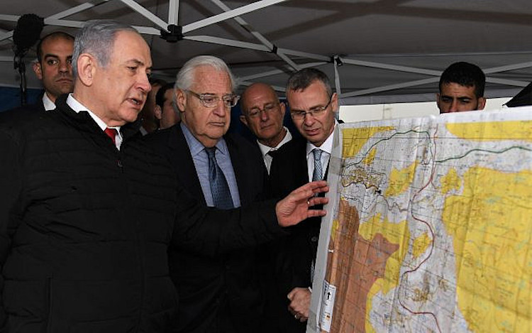 Photo: Prime Minister Benjamin Netanyahu (left), US Ambassador to Israel David Friedman (centre), and then-tourism minister Yariv Levin (right) during a meeting to discuss mapping extension of Israeli sovereignty to areas of the West Bank, held in the Ariel settlement, February 24, 2020. Credit: David Azagury/US Embassy Jerusalem.