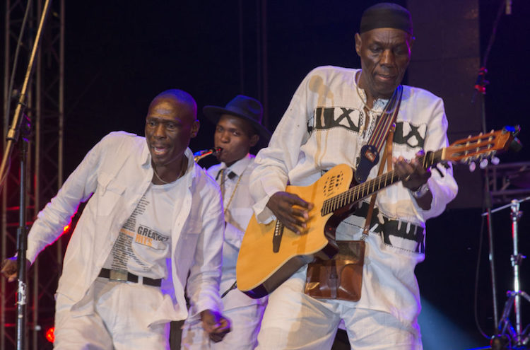 "Photo: Afropop. ""Tuku's band evolved over the years, always maintaining a fundamental integrity. In his late career, his sons performed with him. One son, Sam, was on his way to a promising solo career when he died in a car accident in 2010."" – Banning Eye."