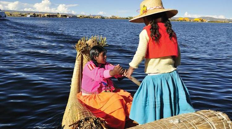 Photo: Two young women row in Lake Titicaca, the highest commercially navigable body of water in the world, near the Uros Islands, Puno, Peru. Credit: unchronicle.un.org