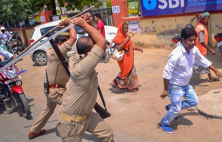 Photo: Police personnel dispersing an activist in a protest demonstration of the marginalized group of the Dalit in Varanasi, India. Credit: PTI. Source: The Print