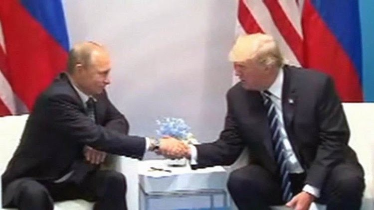 Photo: President Trump Meets with President Putin at G20 summit in Hamburg, Germany. July 7, 2017. Credit: YouTube