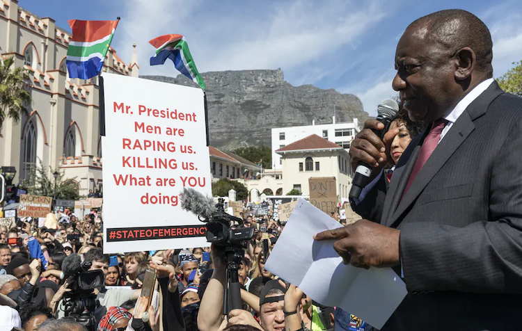 Photo: South African President Cyril Ramaphosa addresses demonstrators protesting against gender-based violence outside Parliament. Source: The Coversation/Nic Bothma