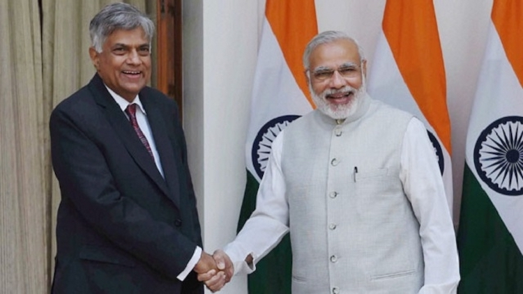 "Photo: Sri Lankan Prime Minister Ranil Wickremasingha (left) with his Indian counterpart Narendra Modi who participated in the International Vesak Day celebrations in Colombo in May 2017. The measured response to the ""crisis"" in India and Australia suggests a greater appreciation of the real situation in Sri Lanka. Credit: Daily News & Analysis (DNA)"