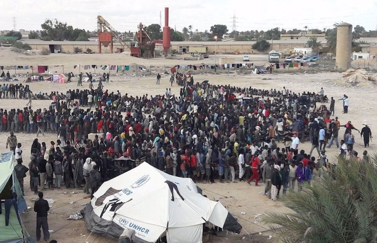 Photo: Refugees and migrants held captive by smugglers in deplorable conditions in Libya. Credit: UNHCR
