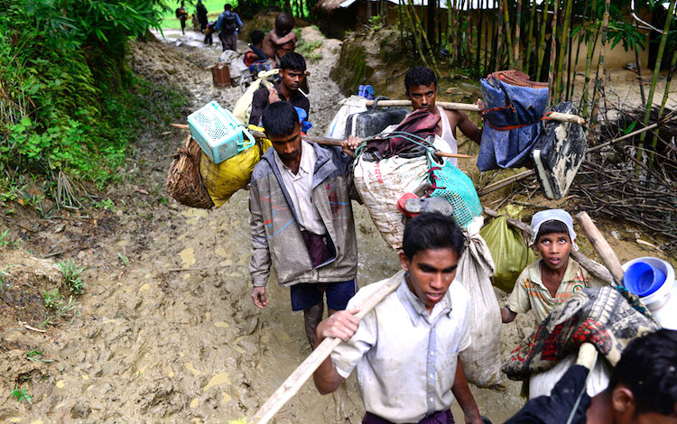 Photo: Rohingya refugees walk towards a refugee camp after crossing the Myanmar-Bangladesh border. Credit: Mahmud Hossain Opu/Dhaka Tribune