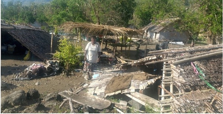 Photo: Rose David of Wusi Village in West Coast Santo, Vanuatu stands next to her home that was destroyed by Category 5 Tropical Cyclone Harold in April 2020. Credit: UN Women/Betty Zinner-Toa.