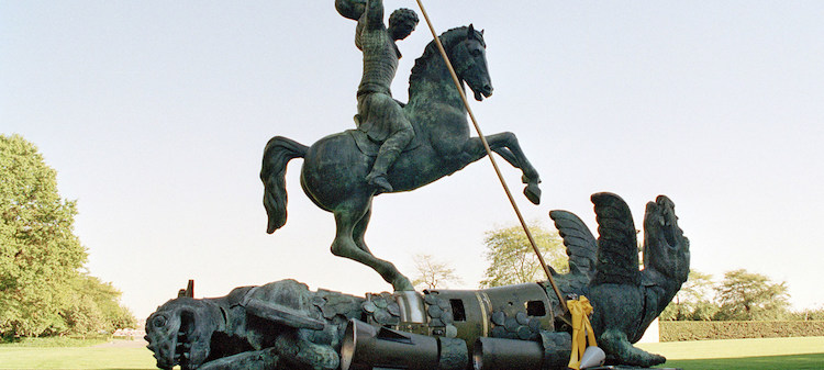 Image: Sculpture depicting St. George slaying the dragon. The dragon is created from fragments of Soviet SS-20 and United States Pershing nuclear missiles. UN Photo/Milton Grant