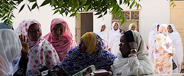 Photo: Women discuss politics at a women's conference in Darfur, Sudan. Credit: UN