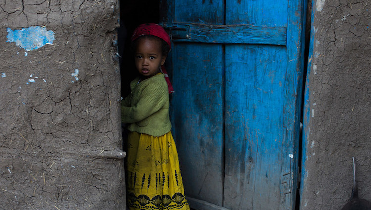 Photo: A girl stands outside her home in the Tigray Region, Ethiopia. Credit: UNICEF/Tanya Bindra