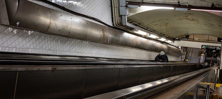 Photo: A lone passenger rides an escalator on the New York City subway at one of the network's busiest stations. The city's tourist industry is likely to be decimated by COVID-19 for the rest of 2020. United Nations/Katya Pugacheva