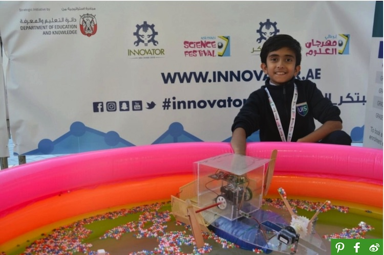 "Photo: Manikandan at the ""INNOVATOR 2018"" event in Abu Dhabi, UAE in February 2018. His innovation, the Marine Robot Cleaner, won the first place as Best Technology Project. Credit: UN Environment."