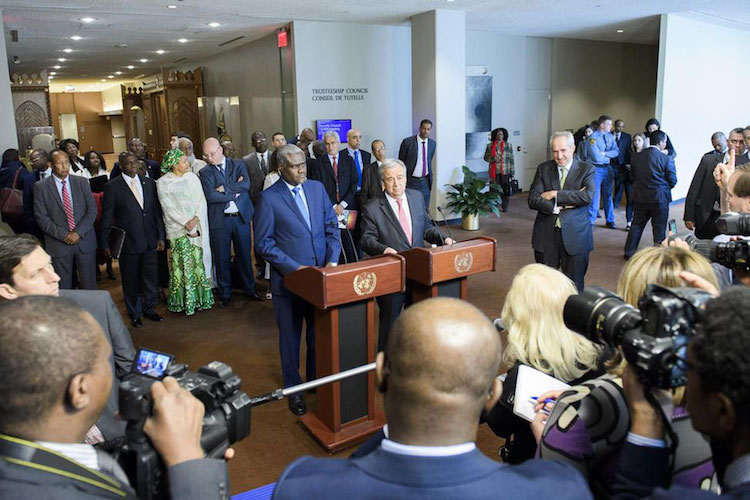 Photo: UN Secretary-General António Guterres (at podium, right) and Moussa Faki Mahamat, Chairperson of the African Union Commission, address the press following the signing of a Joint UN-AU Framework for Enhancing Partnerships on Peace and Security in April 2017 at UN headquarters in New York. UN Photo/Manuel Elias.